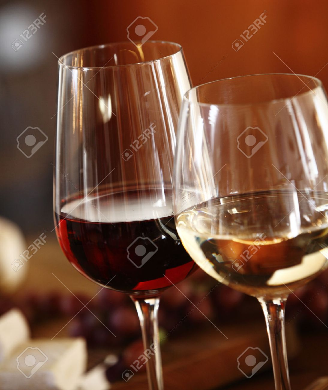 Elegant Glasses Of Red And White Wine Served Together On A Dining Table For  A Formal