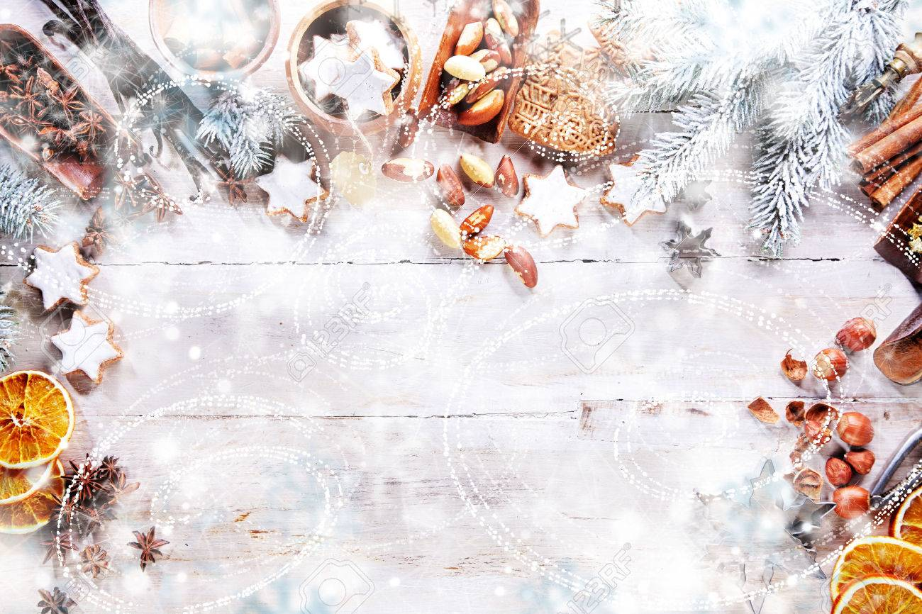 white christmas background with empty copy space cakes and nuts