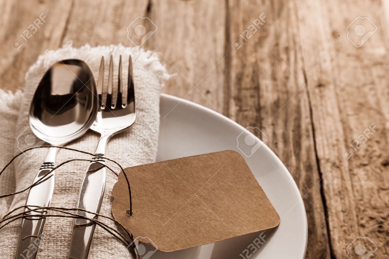 Rustic Christmas place setting with a knife and for on a beige napkin with a blank & Rustic Christmas Place Setting With A Knife And For On A Beige ...