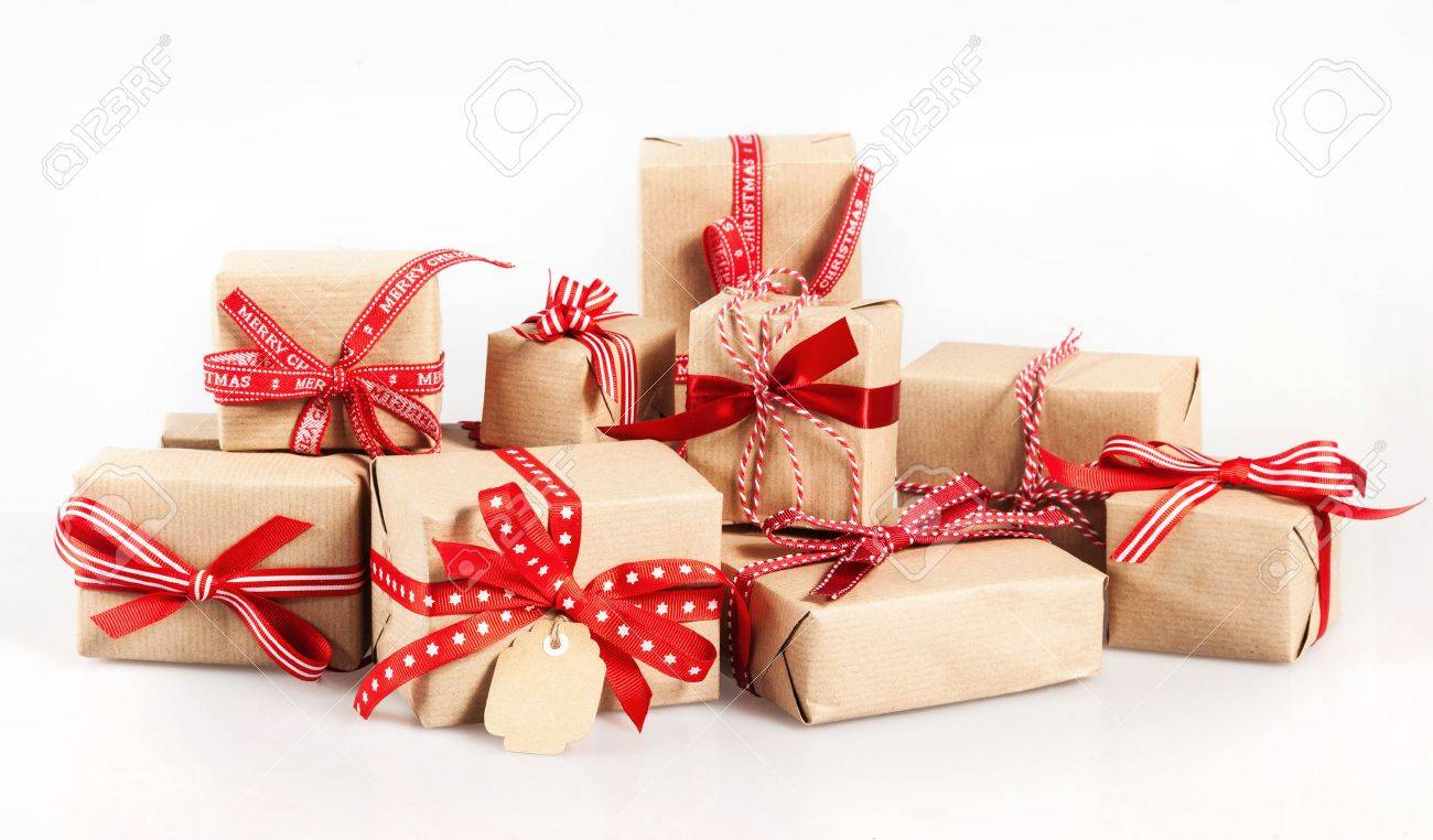 Large Stack Of Decorative Christmas Gifts Wrapped In Brown Paper ...