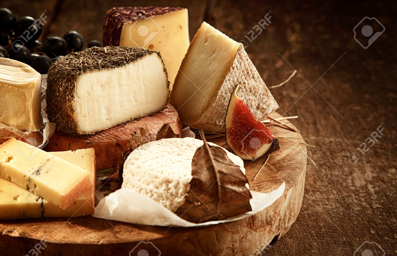 Close Up of Gourmet Cheese Tray Served on Wooden Board - Variety of Cheeses on Rustic & Close Up Of Gourmet Cheese Tray Served On Wooden Board - Variety ...