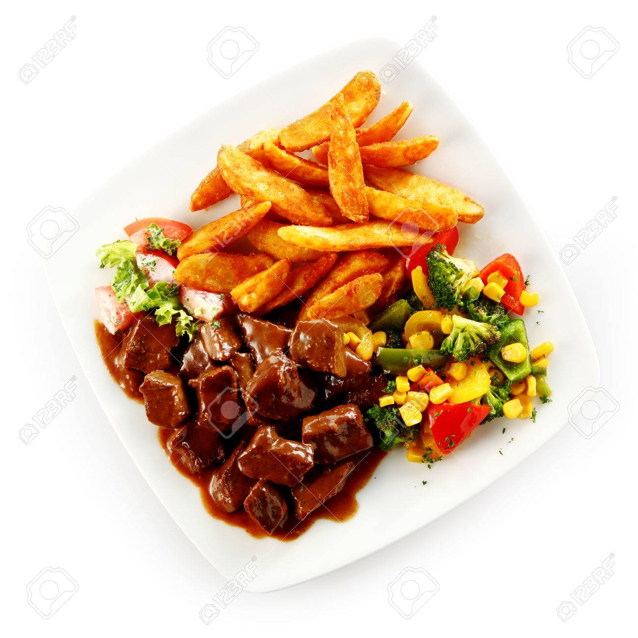 Beef Stew Or Goulash In A Delicious Rich Brown Gravy With Mixed Vegetables And Fried Potato