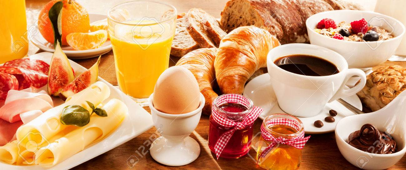 Breakfast feast with egg, meat, bread, coffee and juice - 51721166