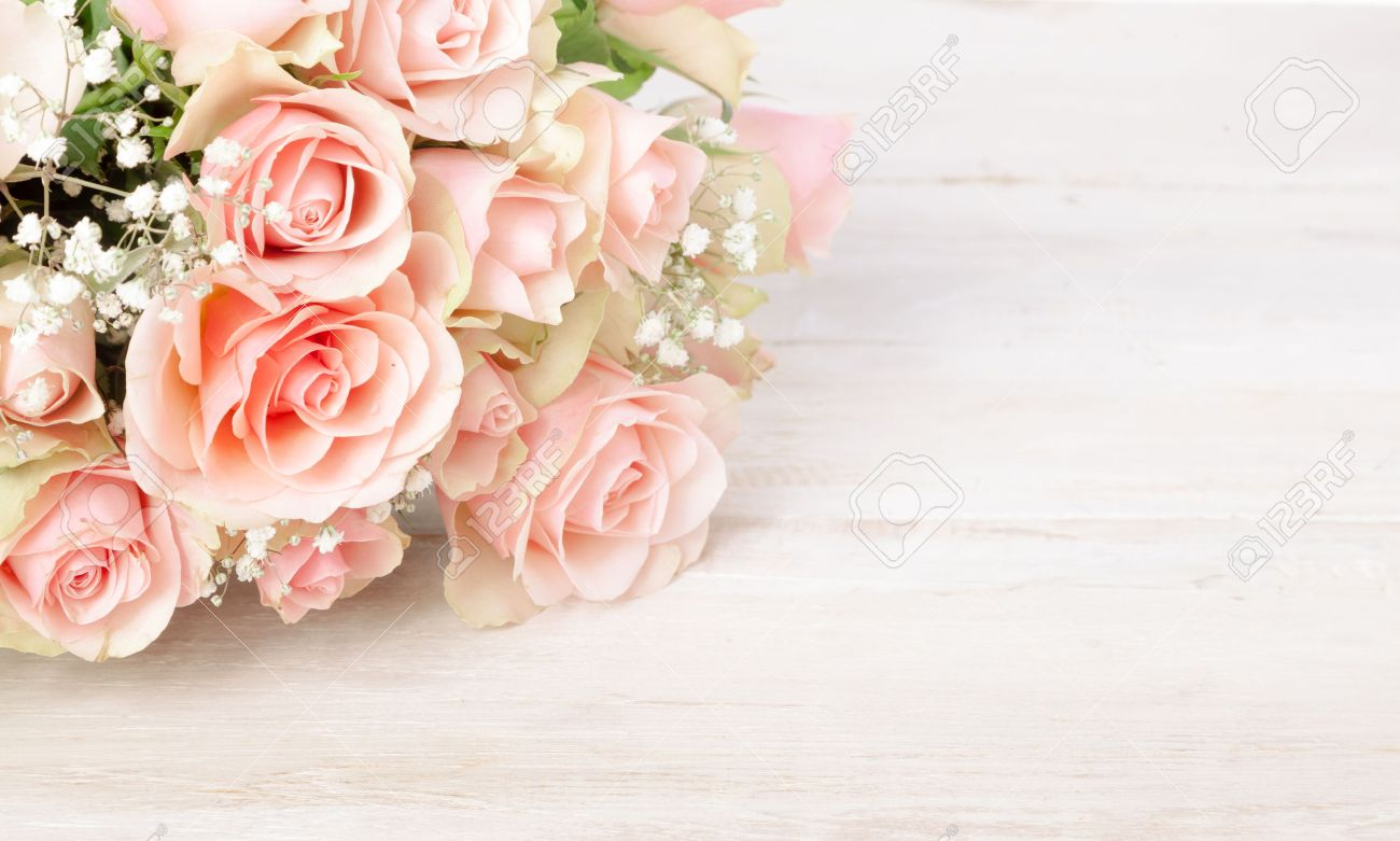 Delicate bouquet of fresh pink roses on a textured white wood background with copy space for your Valentines, Mothers Day, anniversary or birthday wishes - 52284715