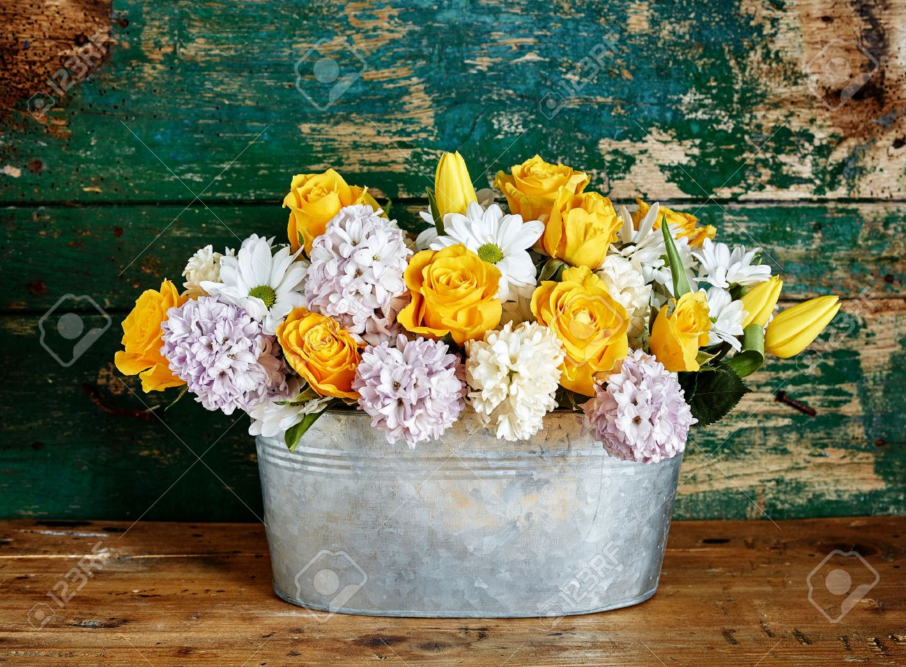 Rustic Floral Arrangement Made Of Yellow Roses Daisies Tulips
