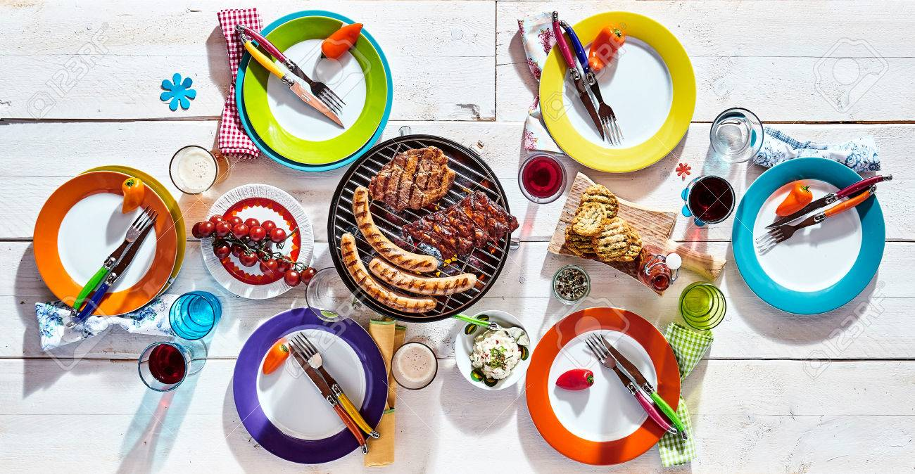 Stock Photo - White picnic table set with colorful dinnerware and barbecued pork sausages bread and fresh fruit with drinks and decorative chili peppers ...  sc 1 st  123RF.com & White Picnic Table Set With Colorful Dinnerware And Barbecued ...