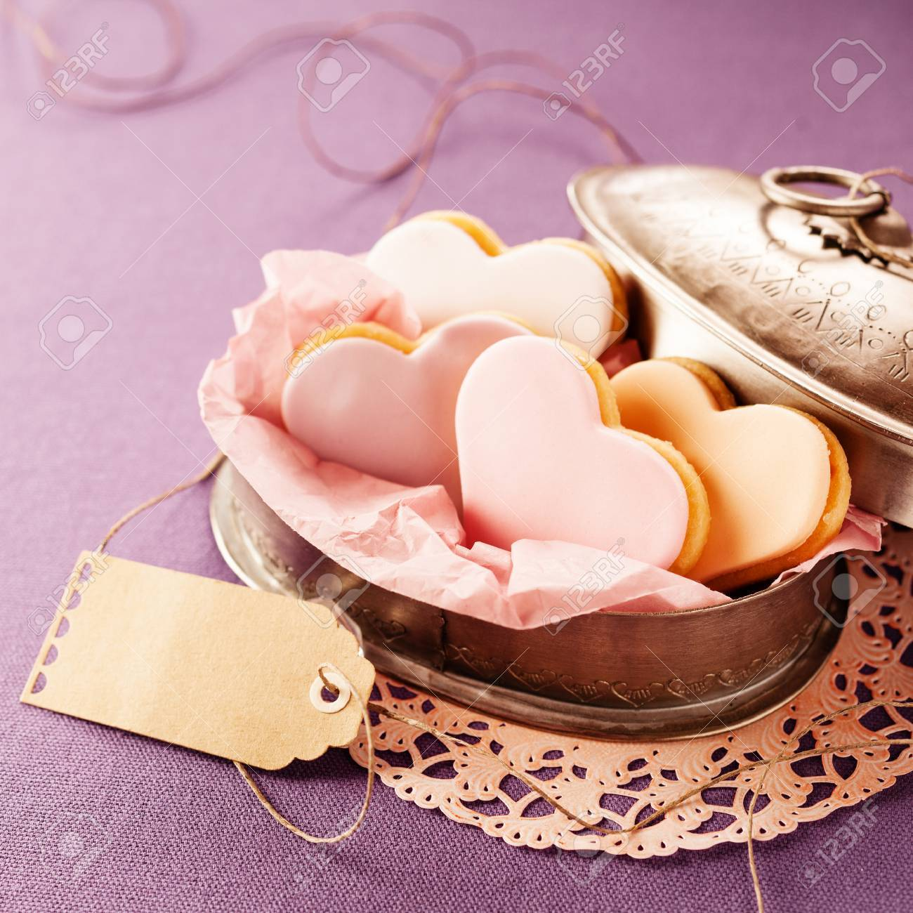 Delicious Heart-shaped Fondant Cookies Served In An Open Vintage ...
