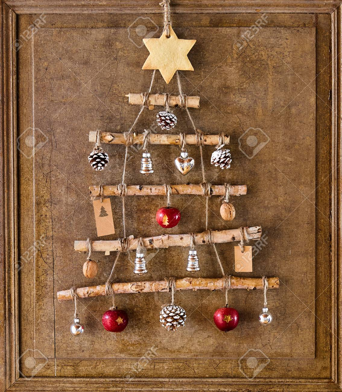 Rustic Christmas Tree Made From Sticks And Ornaments With Large