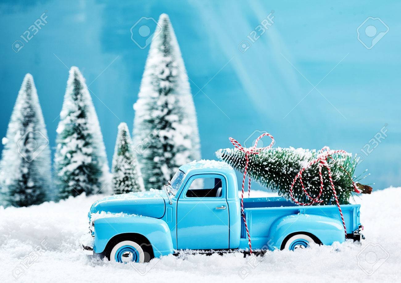 Old Truck With Christmas Tree.Old Blue Vintage Toy Truck With A Christmas Tree Loaded On The