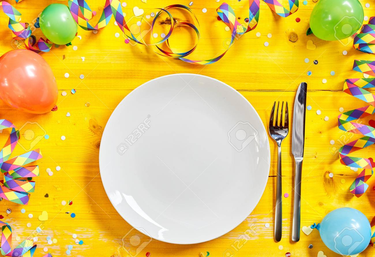 Fun Vibrant Carnival Table Setting With An Empty White Plate.. Stock ...
