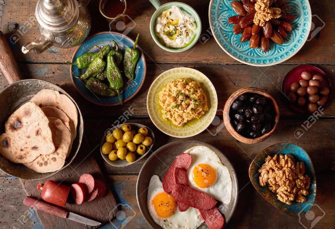Overhead scene of rustic arabian breakfast. Various components of arabic breakfast on an old vintage background plate. - 70888531