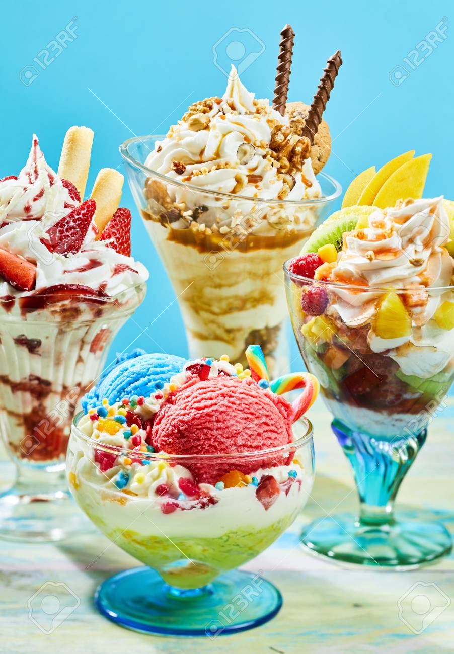 Four Different Flavored Delicious Ice Cream Sundaes On Table Stock Photo Picture And Royalty Free Image Image 76186080