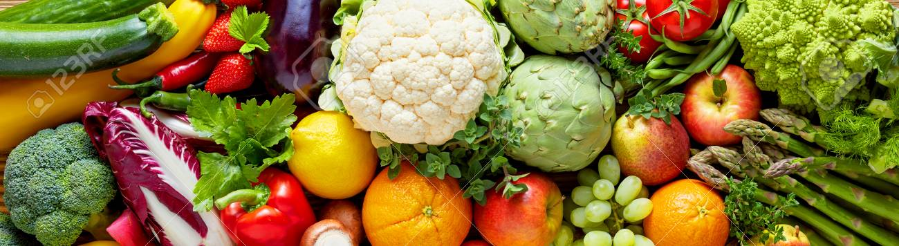 Panoramic wide organic food background concept with full frame pile of fresh vegetables and fruits mix forming bright colorful image - 77253581