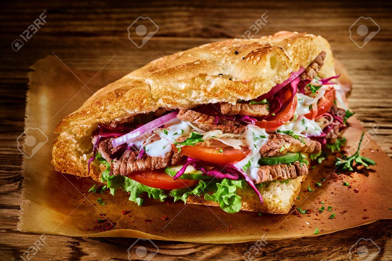 tasty traditional turkish doner kebab with shaved roasted meat