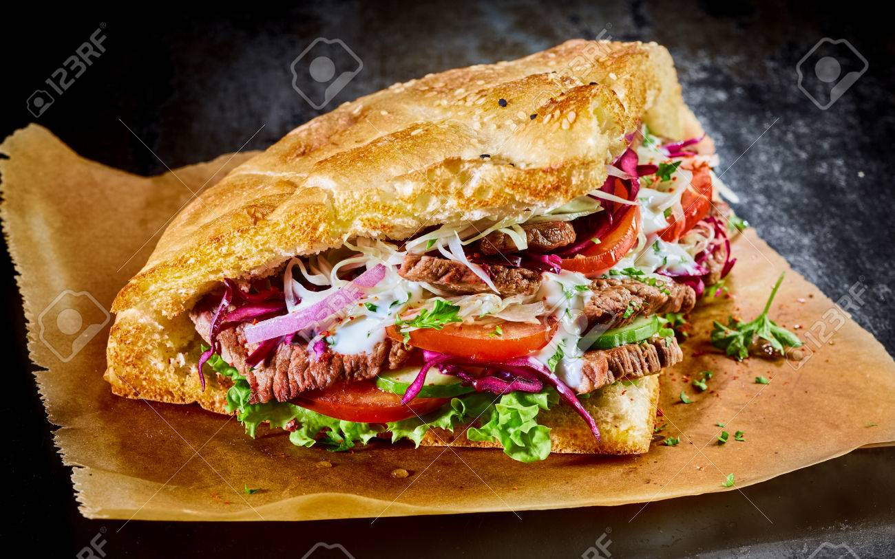 turkish doner kebab on golden toasted pita bread filled with stock