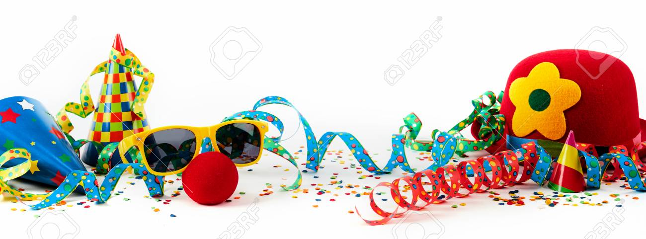 Party or carnival banner with fancy dress accessories and colorful decorations with hats, streamers and confetti in a colorful still life on white - 88255911