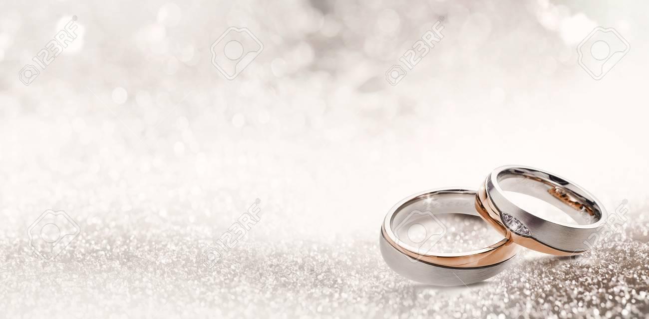Designer Wedding Rings In The Corner On A Sparkling Glitter