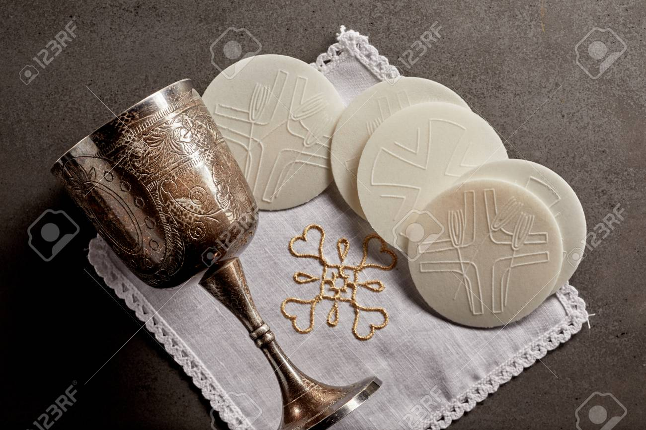 Silver chalice cup and Sacramental bread, or Hosties, symbolising