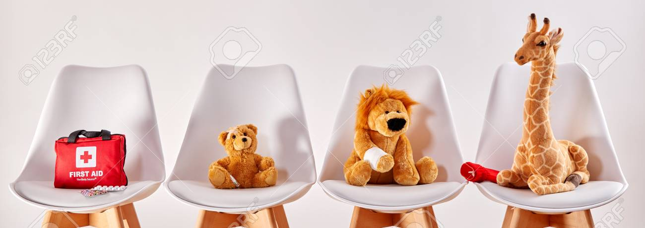 Stock Photo   Three Cute Stuffed Animal Toys On Chairs In The Waiting Room  Of A Modern Hospital Or Health Center For Children