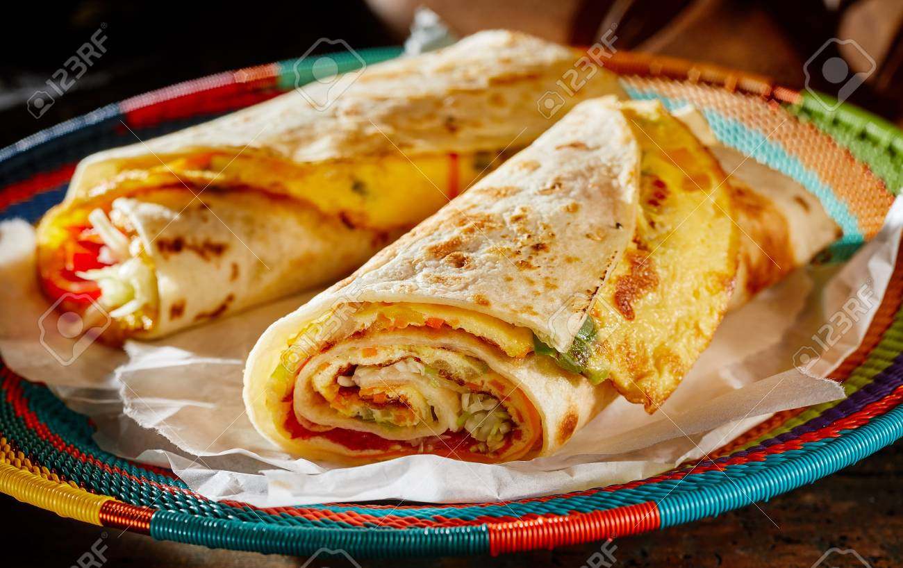 Two delicious indigenous Ugandan Rolex Rolls made with egg omelette..