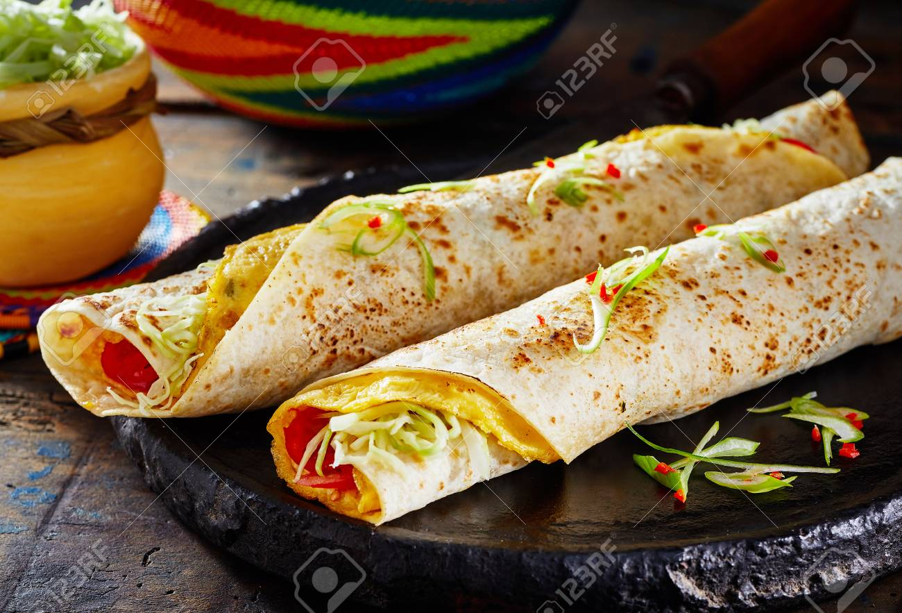 Popular African street food with traditional Rolex Rolls made..