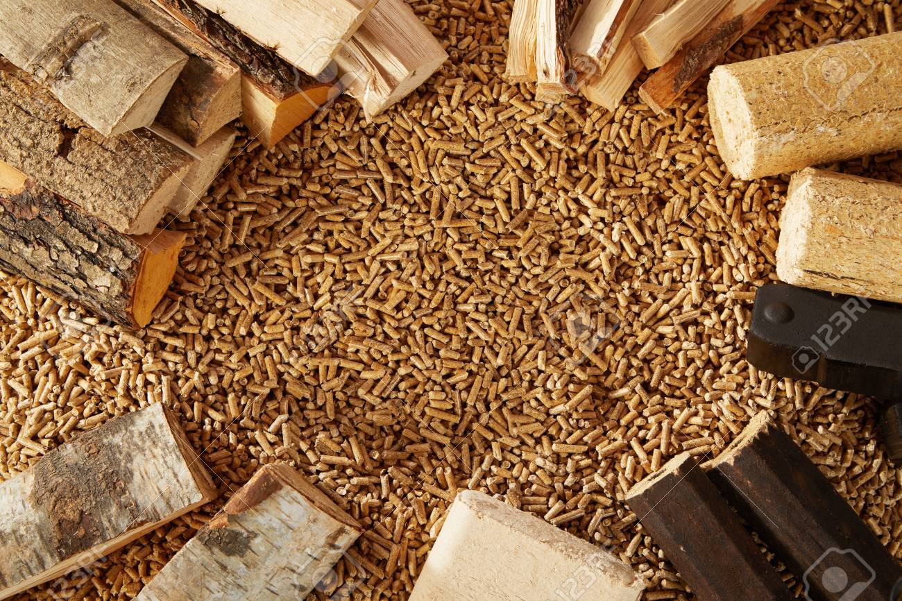 Background made up completely of mounds of wooden pegs and chopped timber logs. Includes copy space. - 108046963