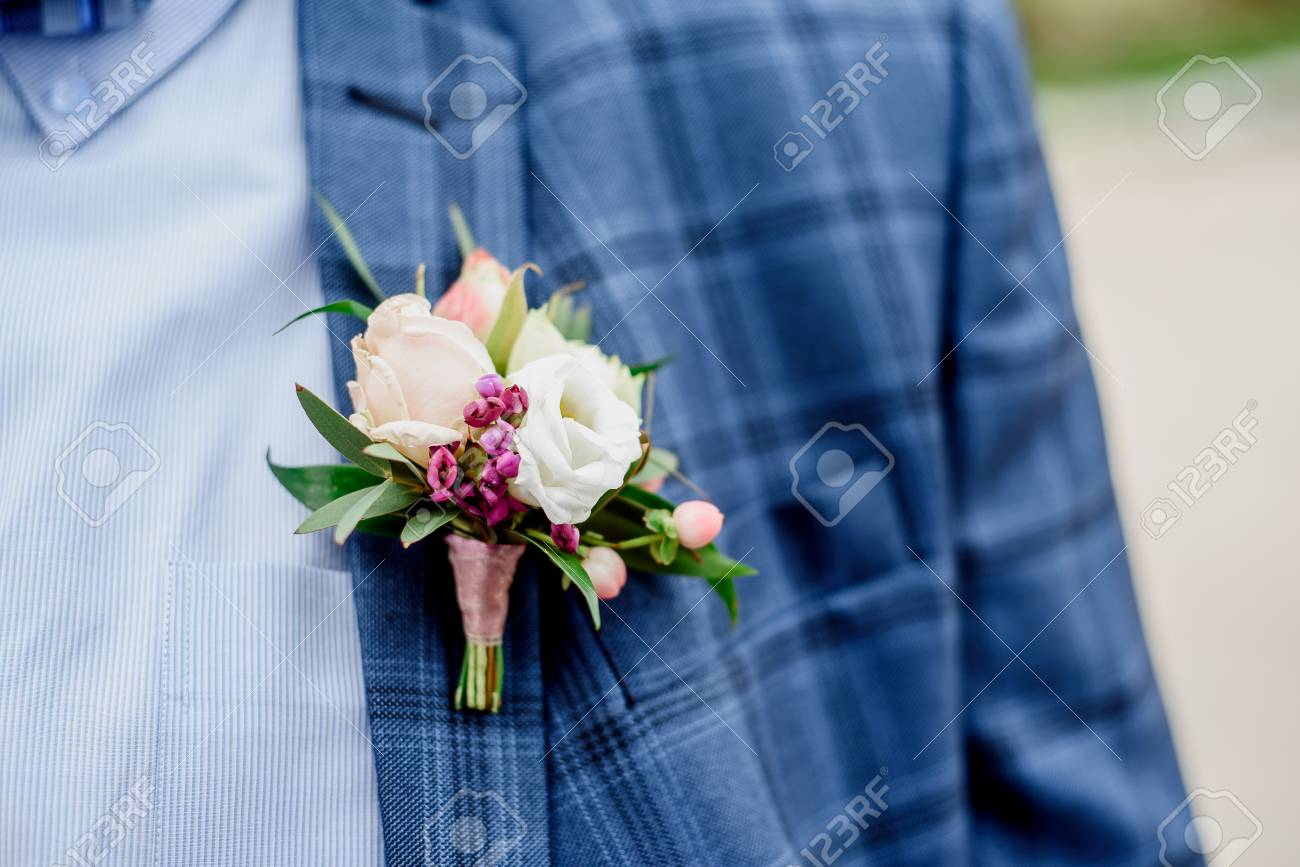 Groom In A Blue Suit With A Boutonniere And A Butterfly Around ...