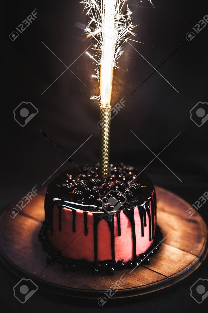 Cake With Berries On A Black Background Festive Candle With Stock