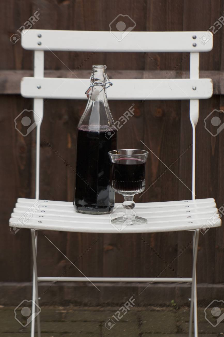 Bottle and glass of wine on a folding table Stock Photo - 15987737