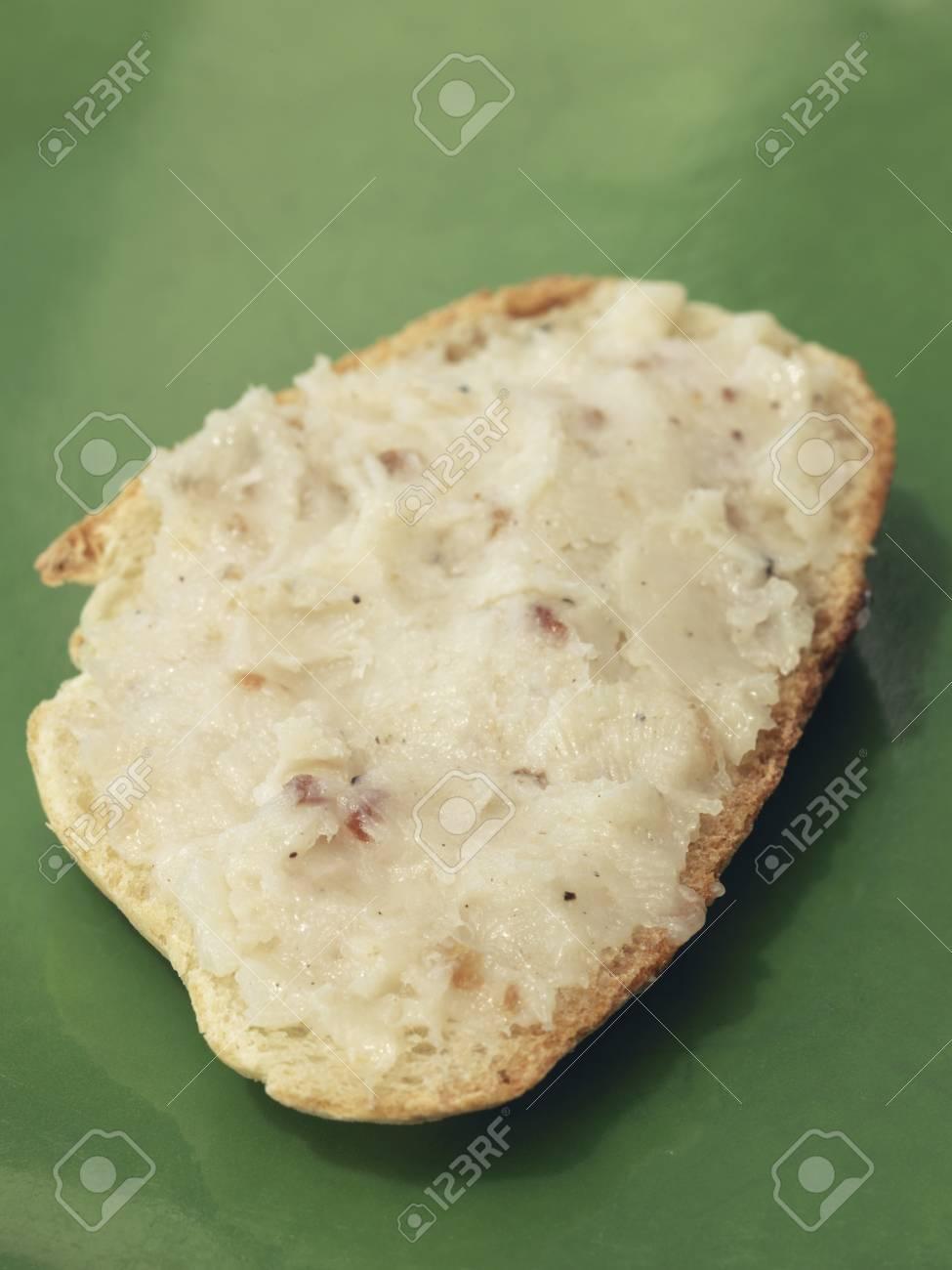Lardo di colonnata on a slice of bread Stock Photo - 17027896