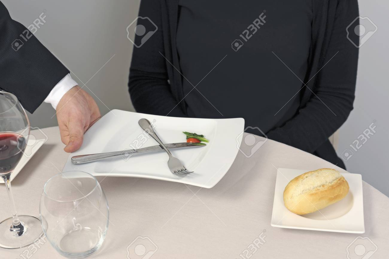 Waiter serving a plate Stock Photo - 17028364