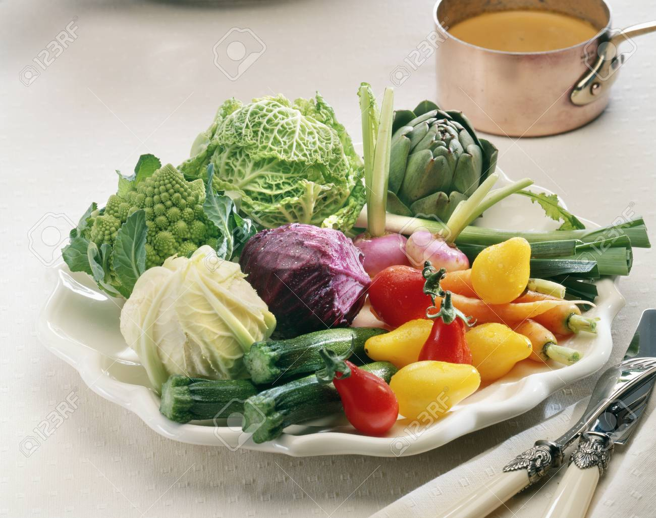 Selection of vegetables and a small copper saucepan of sauce Stock Photo - 17028069