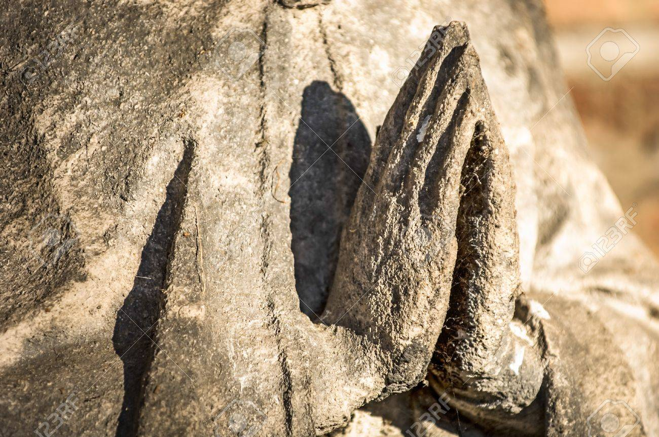 praying hands of an antique statue Stock Photo - 17596556