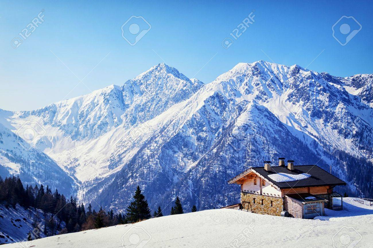 old house at the european alps in winter - 19285601