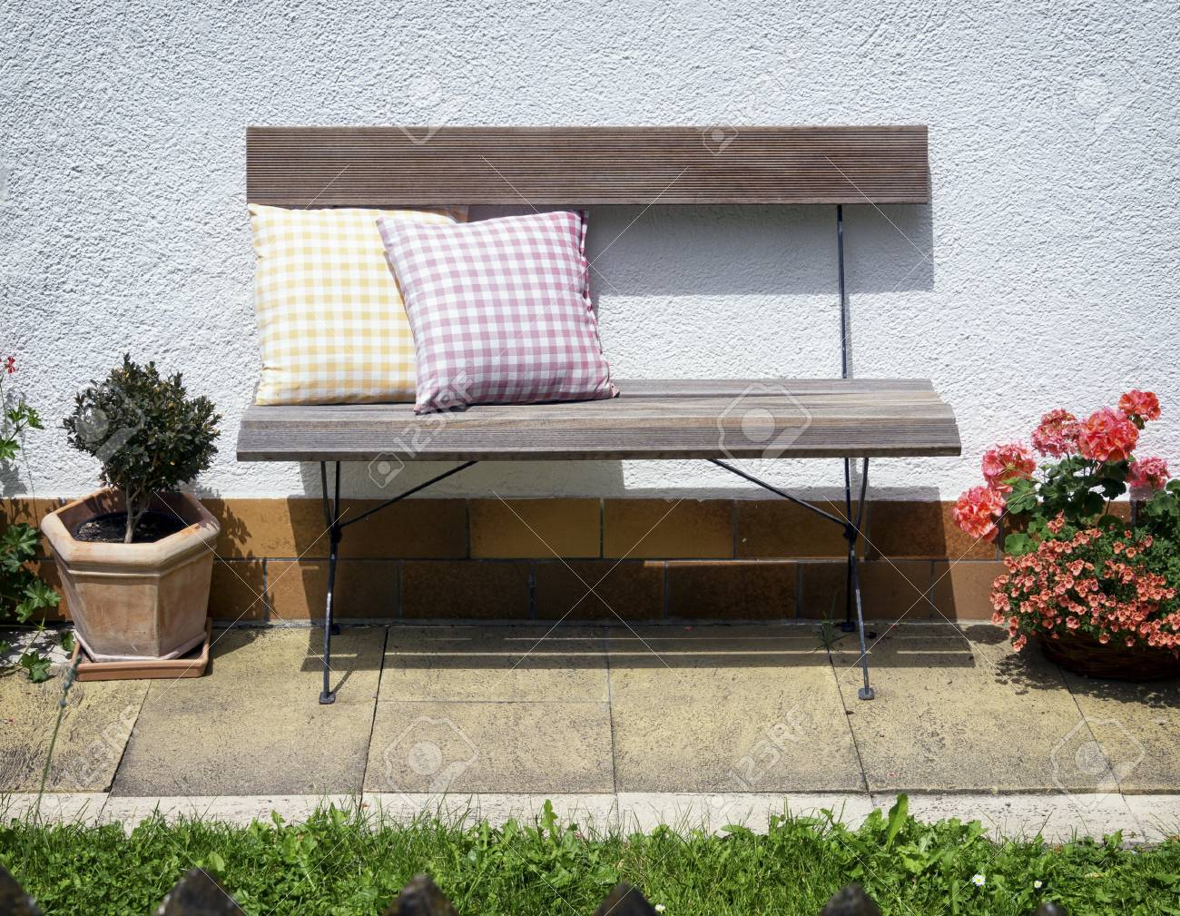 Old Wooden Park Bench And Cushions Stock Photo Picture And Royalty