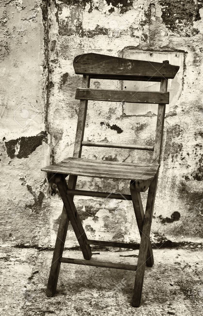 old folding chair at a backyard in rome nice background with