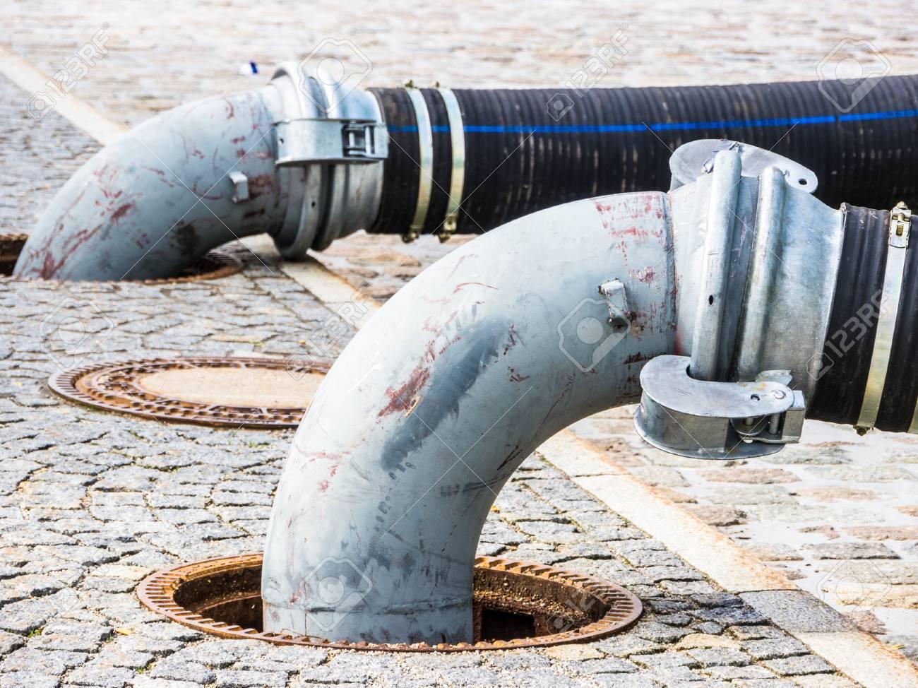 tubes at a sidewalk - photo - closeup - 81216199