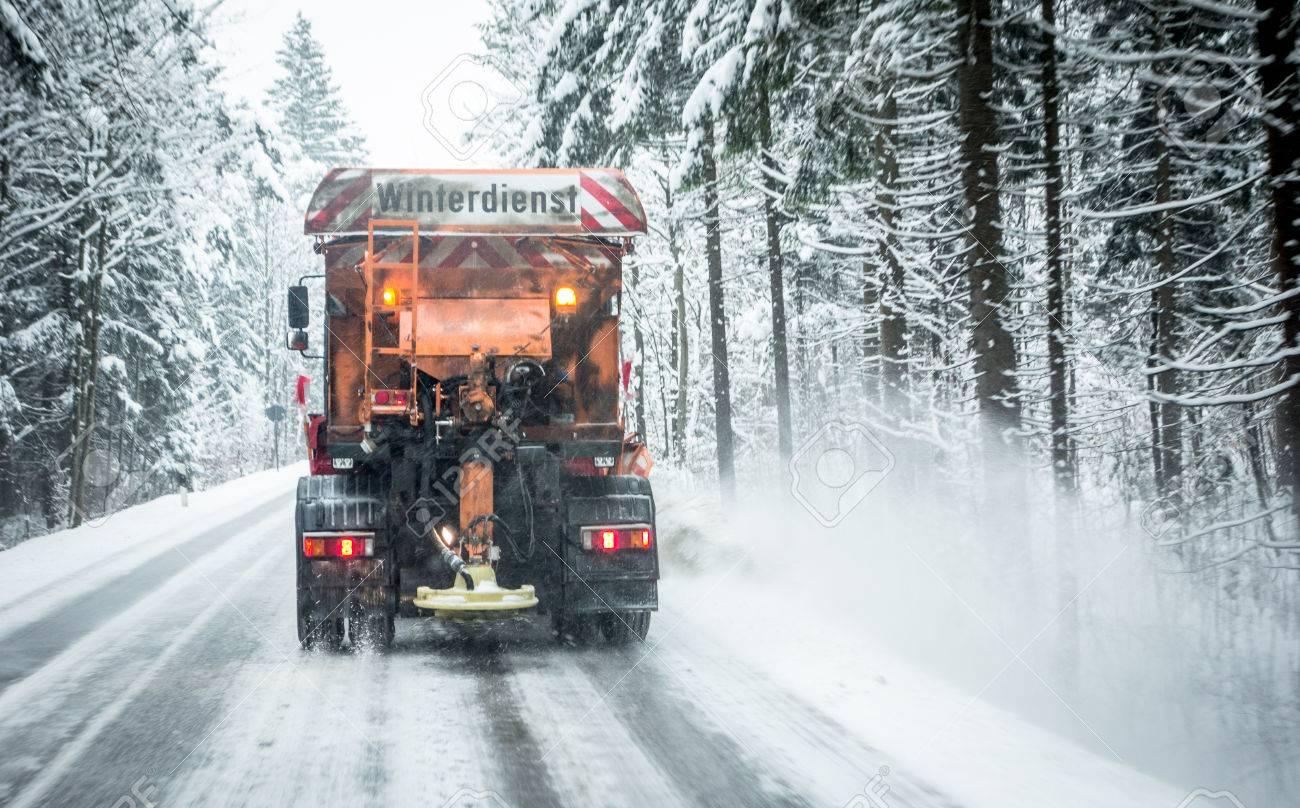 snowplow in winter - austria - europe - german word: winterdienst - 81613101