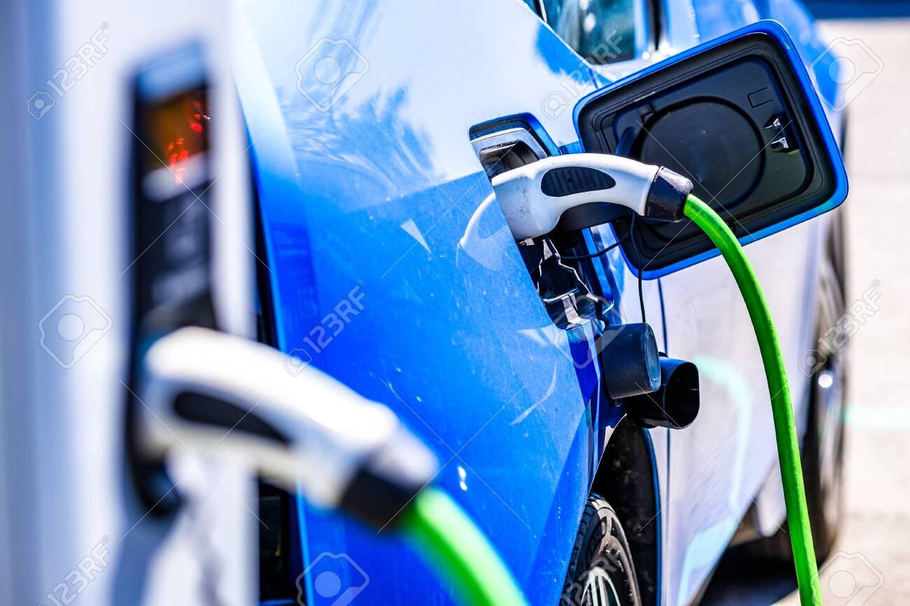 electric car charger - closeup photo - 127445137