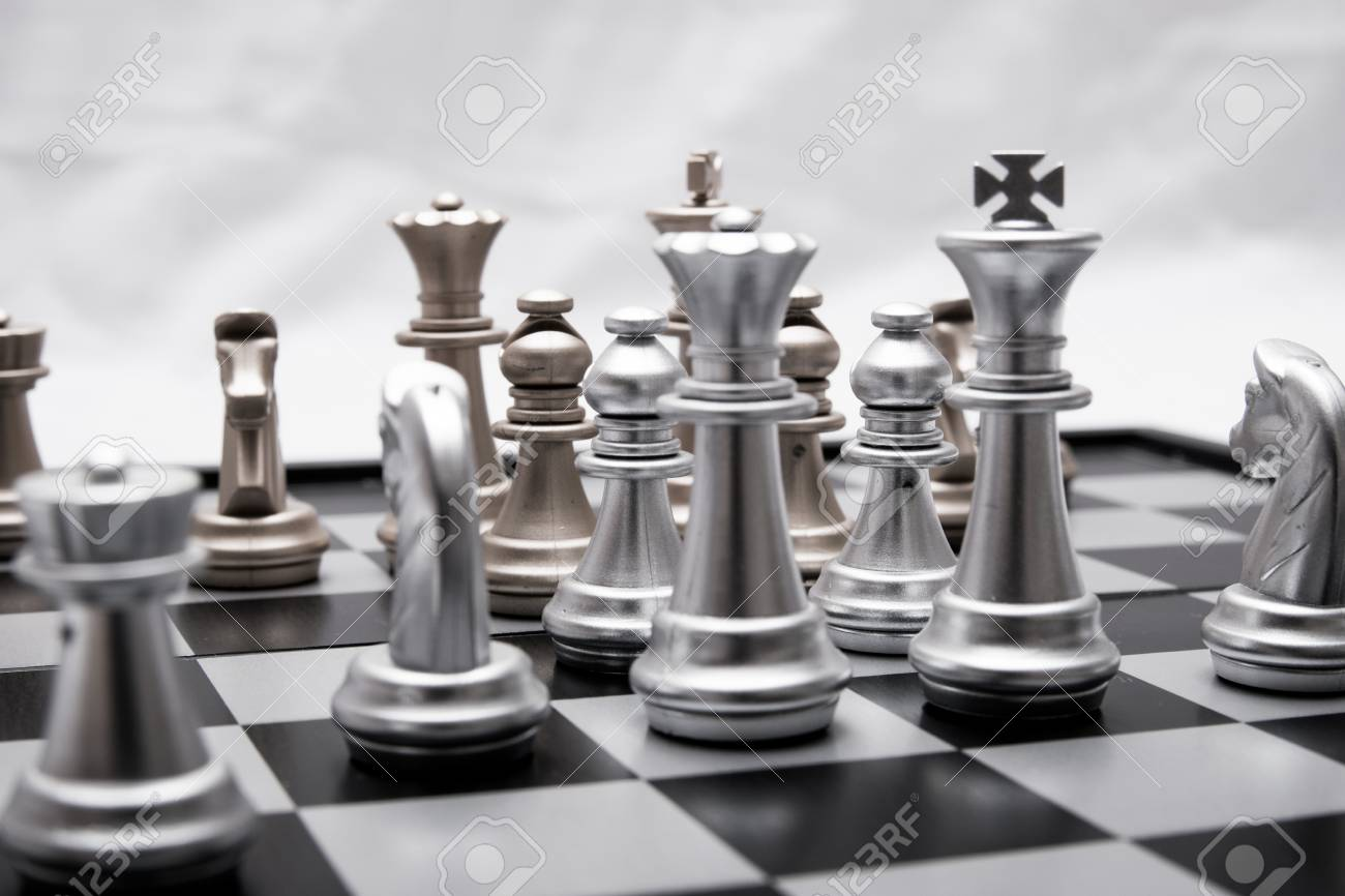chess pieces in different combinations on a black and white board