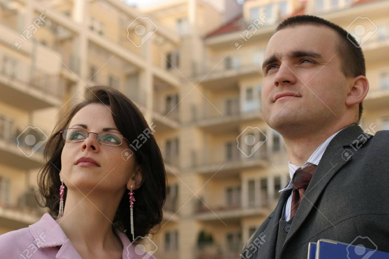 couple in front of appartment block in modern residential area Stock Photo - 679883