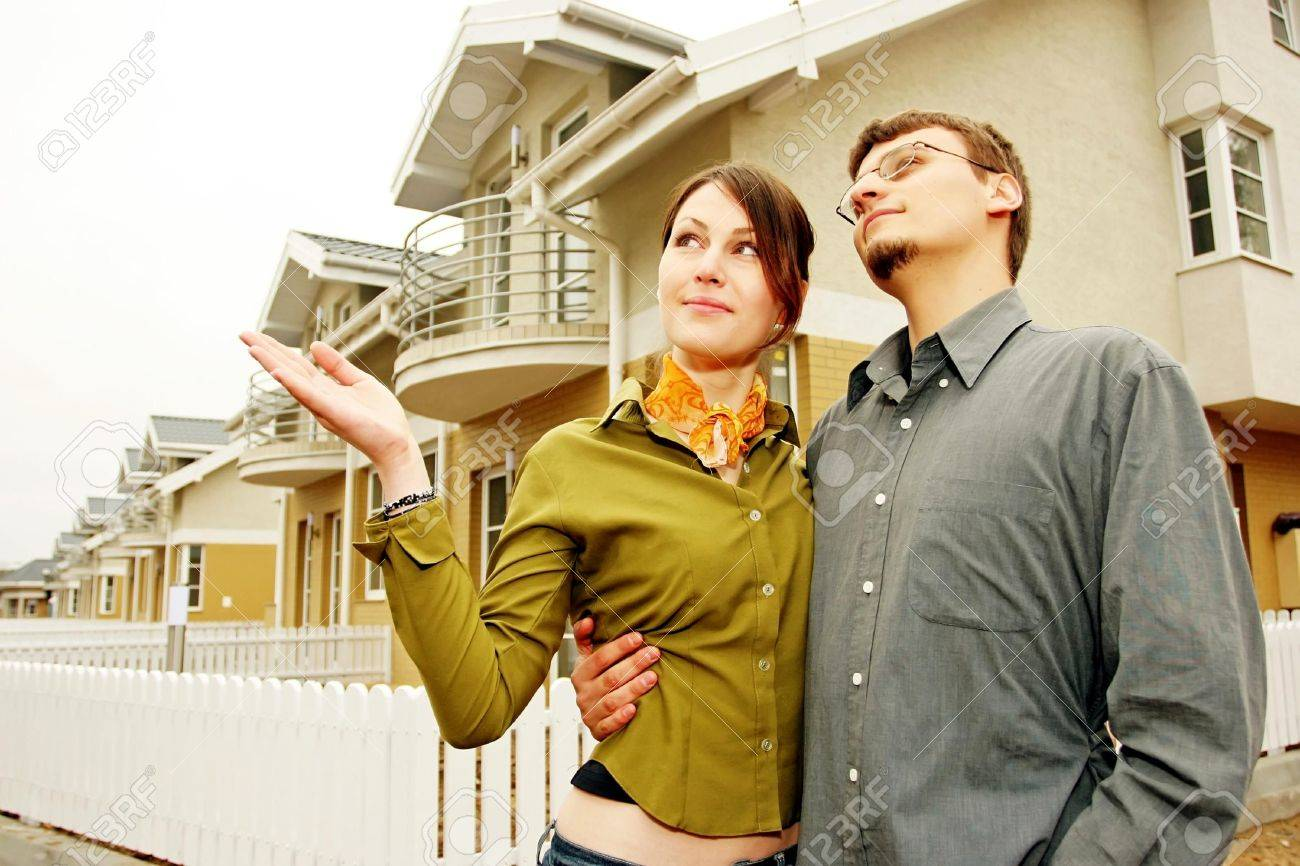 couple in front of one-family house in modern residential area Stock Photo - 679866