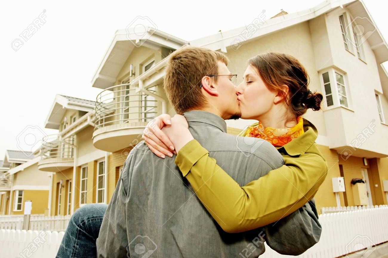 couple in front of one-family house in modern residential area Stock Photo - 679864