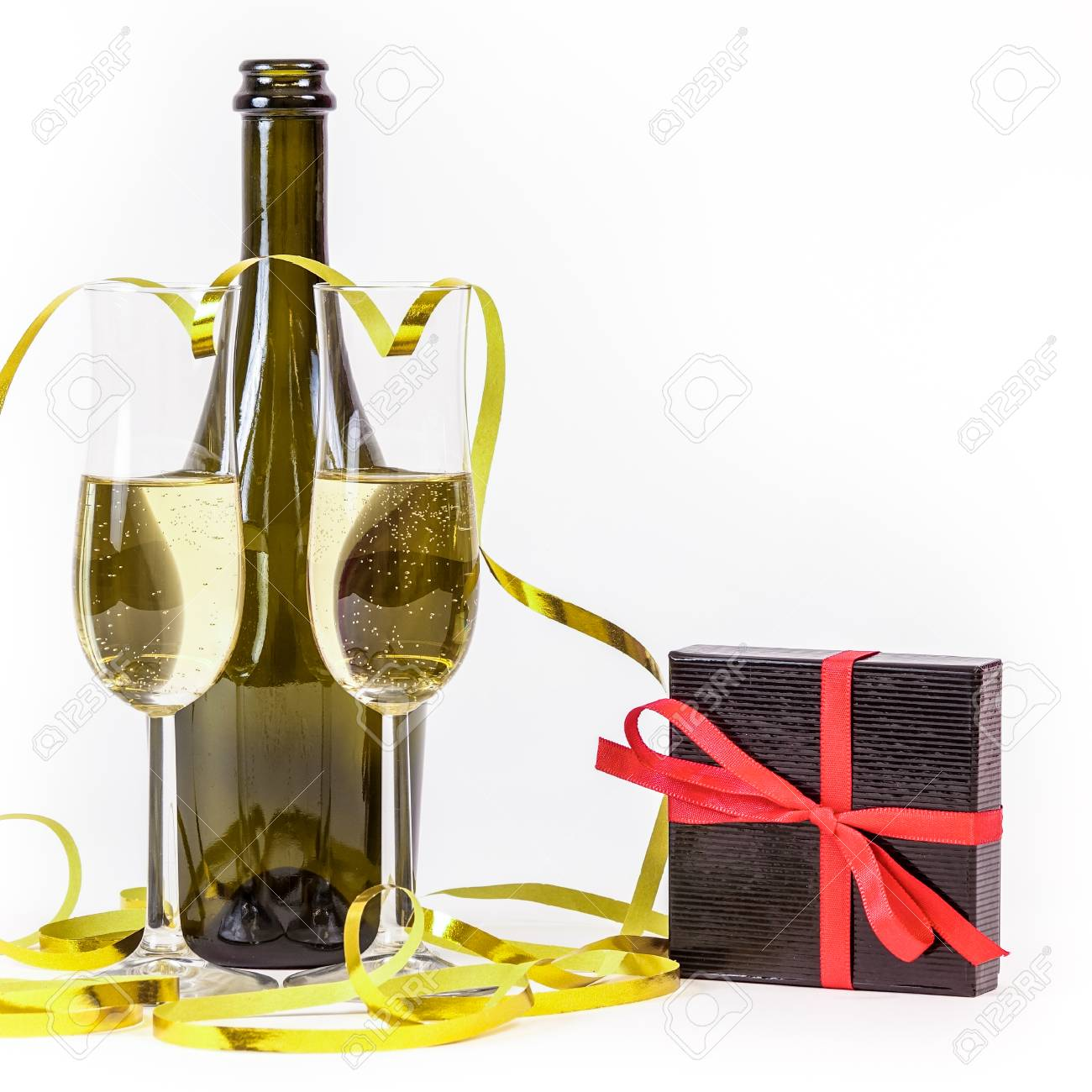 Glasses of ch&agne gift box and party streamers. For new years eve celebration  sc 1 st  123RF.com & Glasses Of Champagne Gift Box And Party Streamers. For New Years ...