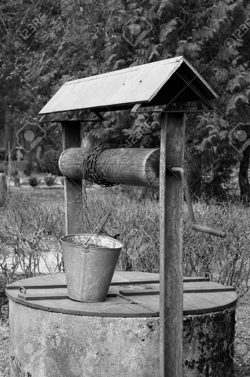 Old well for water on a cemetery  B W Stock Photo - 13529403