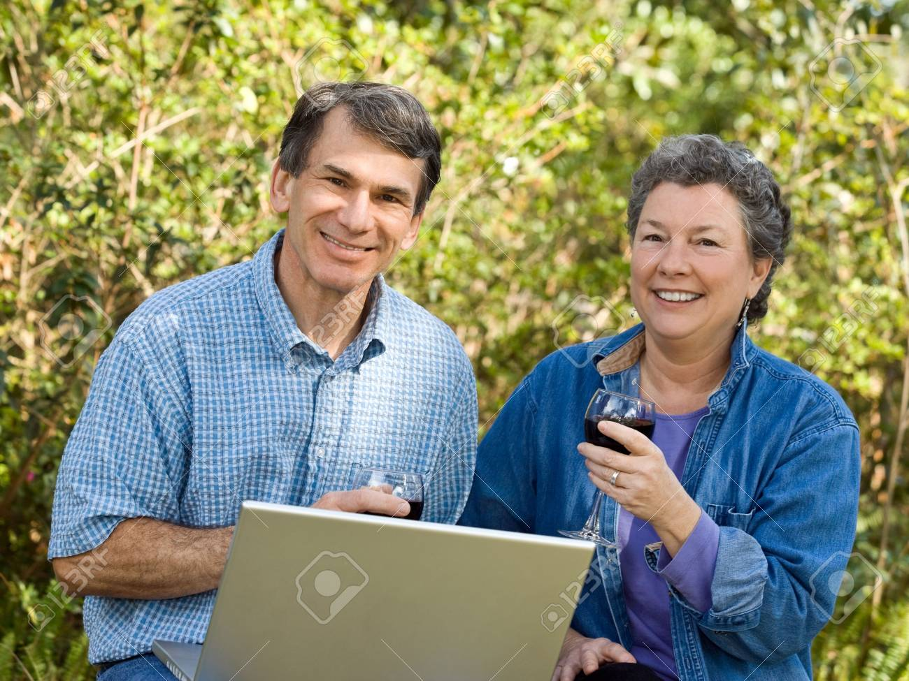 Happy mature couple enjoying wine and planning their retirement options. Stock Photo - 2550986