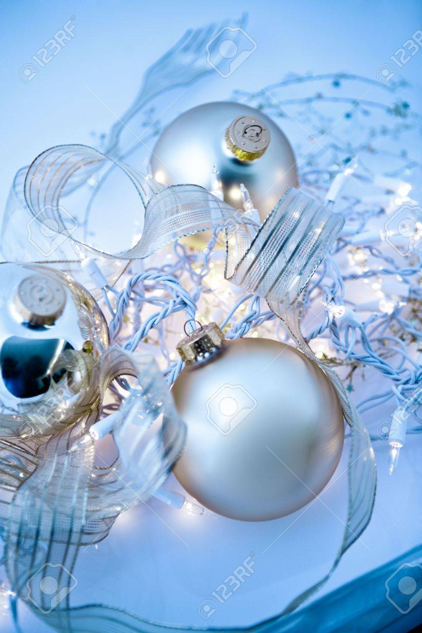 Blue and gold christmas decorations - An Abstract Tangle Of Glowing Silvery Christmas Ornaments With Translucent Ribbons Sparkling Gold Stars And