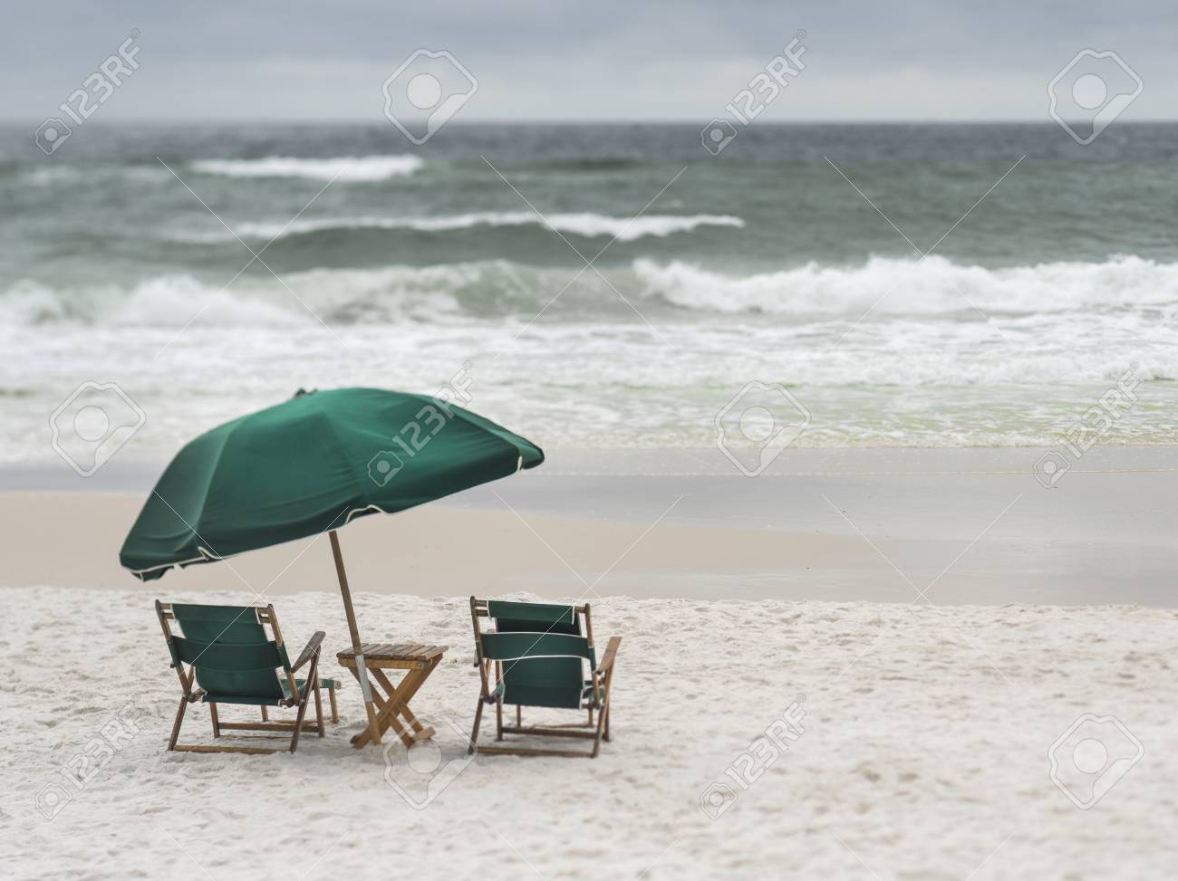 2 Vintage Wood And Canvas Beach Lounge Chairs And Umbrella On Stock Photo Picture And Royalty Free Image Image 107320680