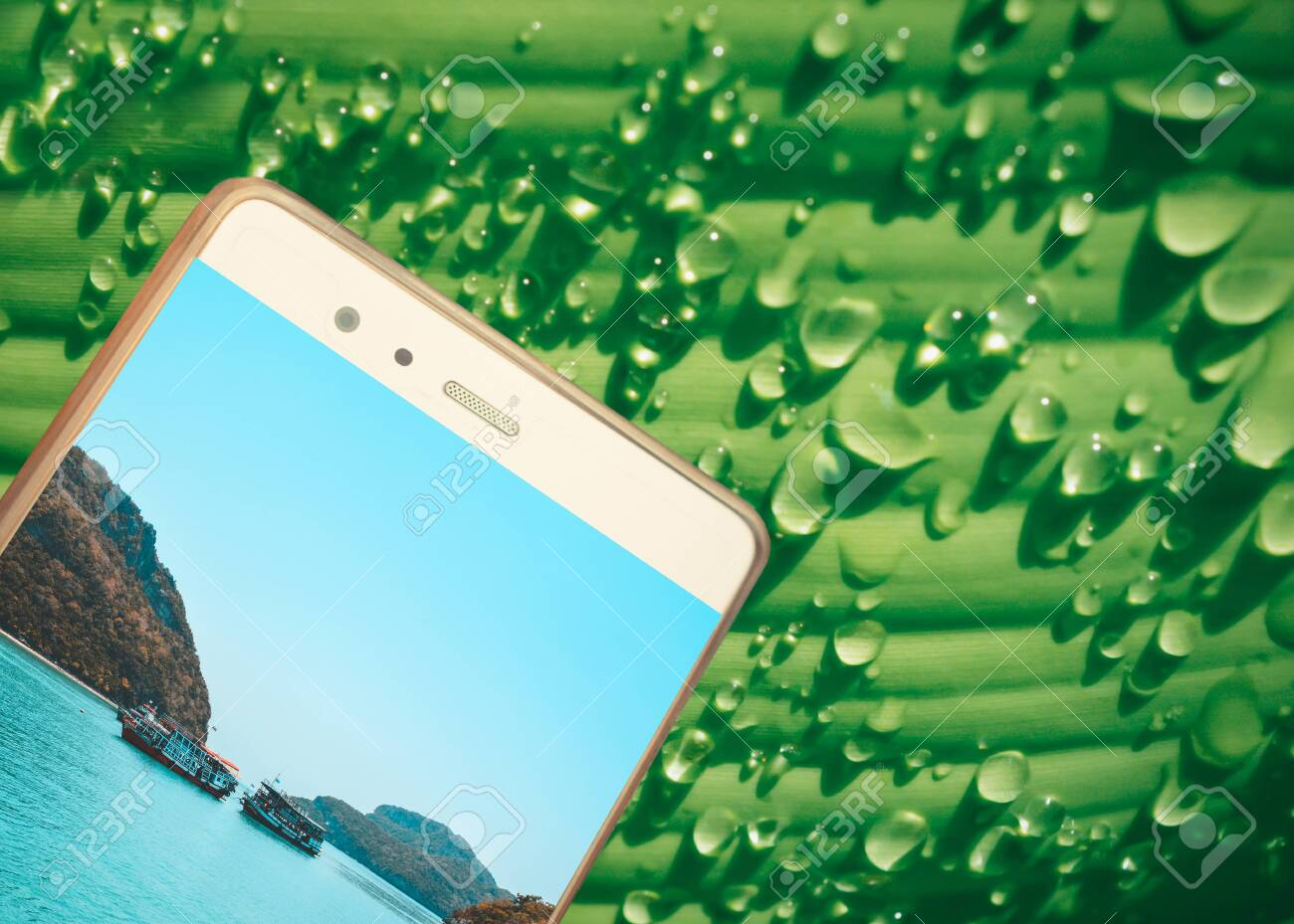 mobile with island picture on green leaf with dew drop texture