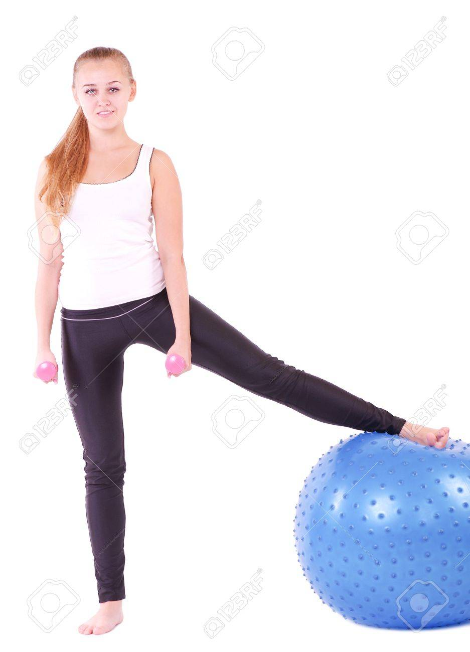 Young woman in gym with a blue ball Stock Photo - 12010257